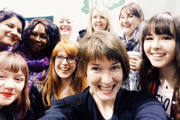 A group selfie of several diverse women, smiling.