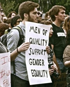 Man holding sign: 'Men of quality support gender equality