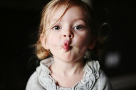 Toddler making fish or kiss face