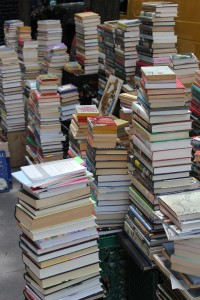 Several tall piles of books.