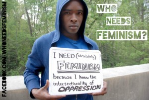 Man holding whiteboard: I need (absolutely) feminism because I know the intersectionality of oppression