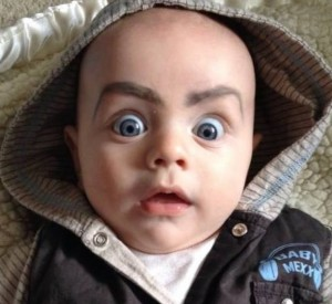 Baby with eyebrows drawn on