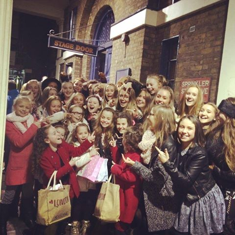 Hannah Howland with McKechnie Dance School classmates after a show