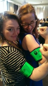 Caitlin Goodale and friend poses with X-box armbands