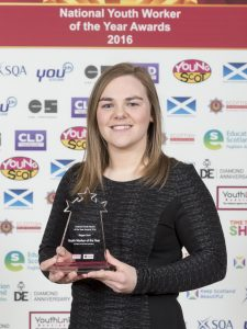 Megan Scott holding her youth worker of the year award