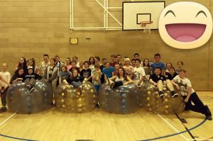 The Callander Youth Project group playing inflatable bubble football.