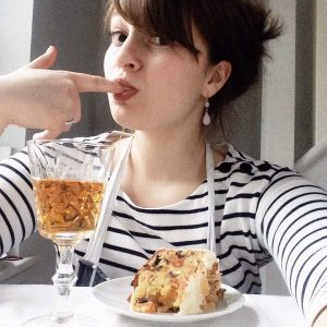 Flora Shedden takes a selfie with a glass of whisky and a slice of Christmas cake