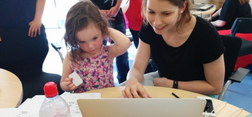 Timea showing kids how to code.