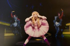 Hannah Howland as Veruca Salt on stage in Charlie and the Chocolate Factory