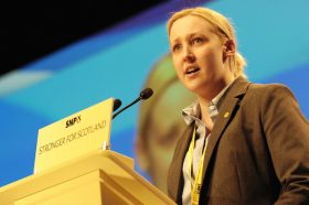 Mhairi Black speaks from a podium at the SNP Spring Conference in 2015